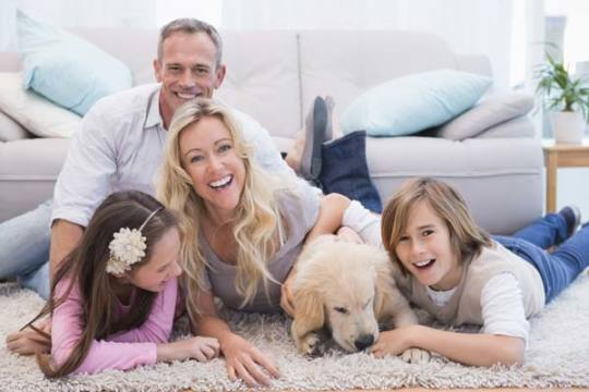 family and dog in the living room